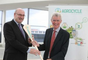 Professor Shane Ward, UCD School of Biosystems and Food Engineering, presents Phil Hogan, European Commissioner for Agriculture and Rural Development, with the AgroCycle hurley during the launch of the €8 million AgroCycle 'circular economy' project.